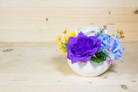 Beautiful flower vase on a wood background