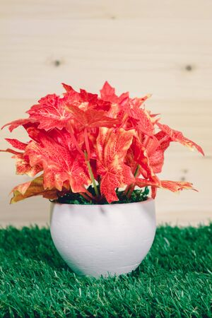 Fake tree vases on a grassy background