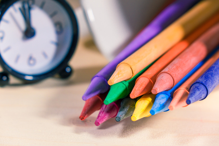 Crayon ,Many colorful  on a wooden background.