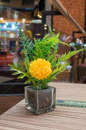 Flower vases on wooden table Stock Photo
