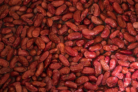 Red beans are boiled to cook food.
