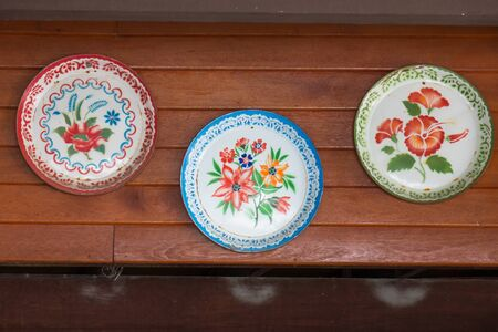 Traditional food tray showcases prettiness on wooden walls. Stock Photo
