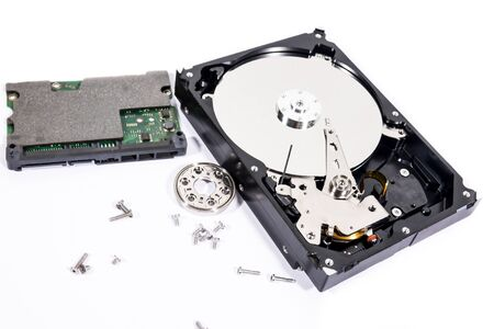 Components inside the harddisk are being removed. Stock Photo