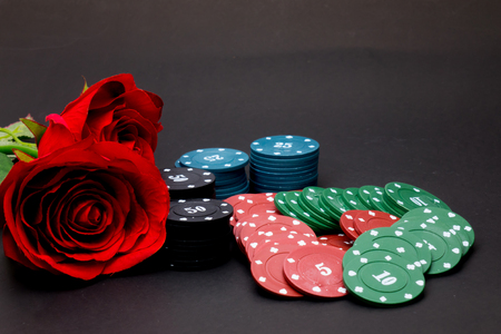 playing poker and looking at cards , risk game poker table during a game. Chips, money and cards  item isolated on black background