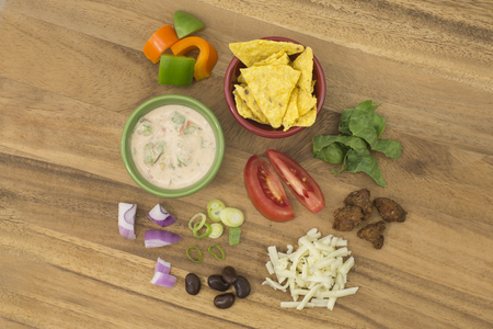 Taco Salad with Salsa Dressing ingredients on cutting board, overhead view