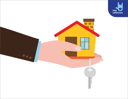 Closeup. Hand agent with home in palm and key on finger.Rental of Real Estate business concept.Offer of purchase house.