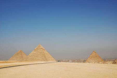 pharoah: the great pyramids of giza in Egypt with cairo in the background Stock Photo
