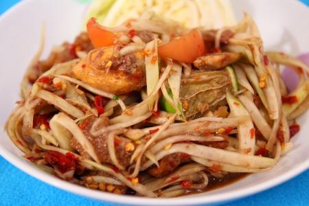 tam: Som Tam is spicy green papaya salad Thai food