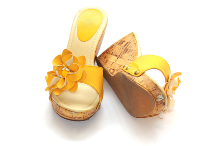 Yellow shoes on the white background Stock Photo - 24435057