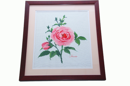 Picture frame Cross Stitch  hanging on the wall Stock fotó