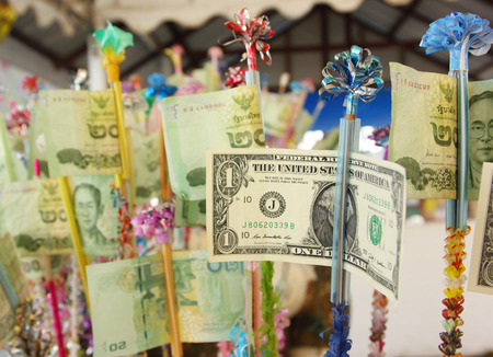 smacker: money dedicated to Buddhism in Thailand Stock Photo