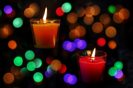 Bokeh beautiful  light and  fragrance candle in the darkness photo