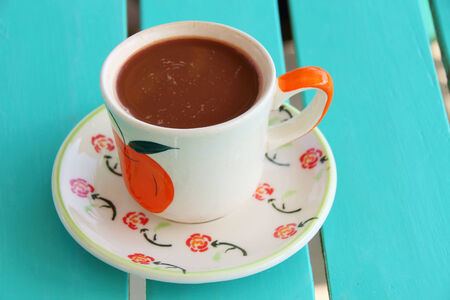 potation: Hot cocoa on the table blue