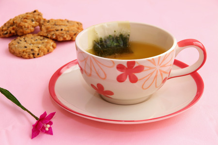 potation: hot tea and cookies on the table