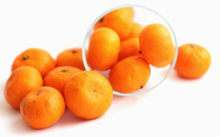 Place the orange in glass on a white background photo