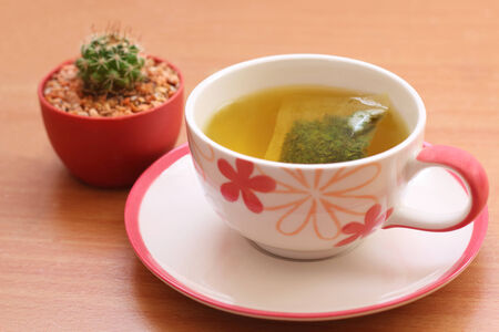 tea breaks: Hot tea and cactus placed on the table
