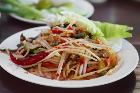 Som Tam is spicy green papaya salad Thai food photo