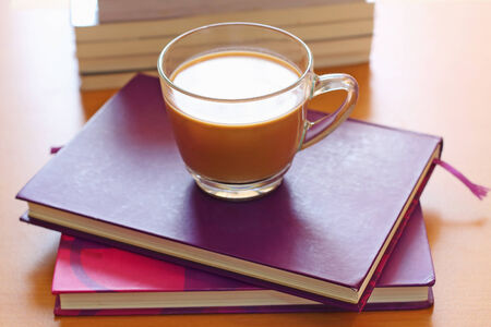 potation: Hot coffee put on the purple and wooden table