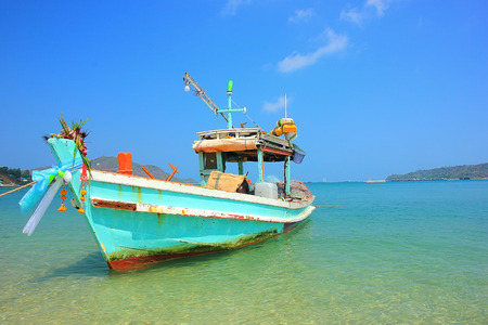 Fishing boats floating in the blue sea at Thailand photo