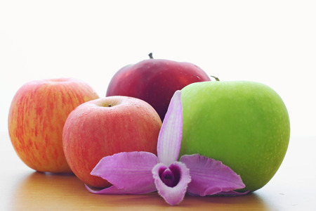 highkey: apples and purple orchid on the wooden table