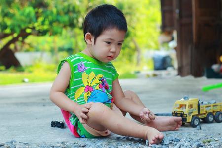 Asain boy playing the toys photo