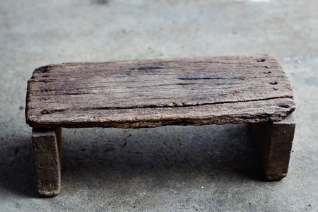 cement floor: Old wooden stool on the cement floor
