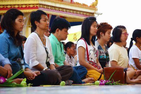 ang thong: Ang Thong, Thailand-July 11,2014: Buddhists and monks meditation round the temple, in Asaha Puja Day and the beginning of Buddhist Lent, at Wat Muang- Ang Thong, Thailand.  Editorial