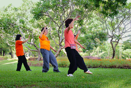 Bangkok, Thailand-July 24, 2014: Elderly Asian Exercise, Tai Chi for Health at the park in Bangkok,Thailand on July 24, 2014.