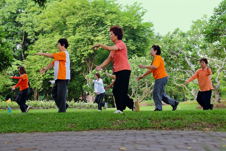 hoary: Bangkok, Thailand-July 24, 2014  Elderly Asian Exercise, Tai Chi for Health at the park in Bangkok,Thailand on July 24, 2014