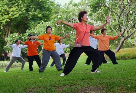 Bangkok, Thailand-July 24, 2014: Elderly Asian Exercise, Tai Chi for Health at the park in Bangkok,Thailand on July 24, 2014. Sajtókép