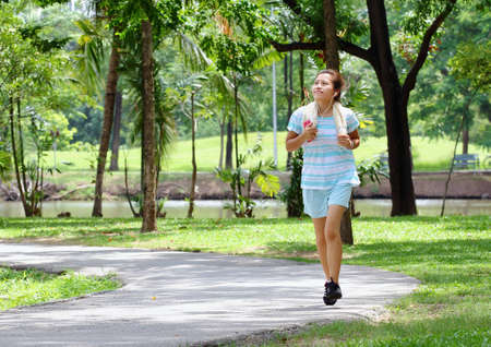 Asian women jogging in the park Stock Photo