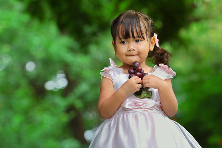 Little asian girl was playing happily in the park photo