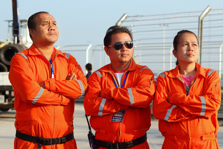 buriram: Buriram THAILAND - October 5:Marshal was prepared to work in the Super GT race car 2014 at Chang International Circuit in Buriram United, on October 4-5, 2014 at the Buriram, Thailand.