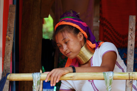 lineage: Mae Hong Son, Thailand - November 9:Unidentified Karen Long Neck at the Ban Huay Sua Thao in Mae Hong Son, Thailand on November 9, 2014. Karen is migration from Burma, The suppression of minorities.