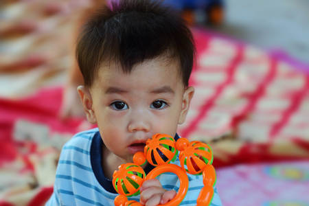 baby playing toy: asian baby playing toy