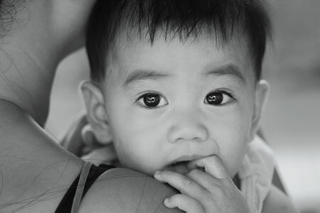 perverse: asian baby black and white,monochrome