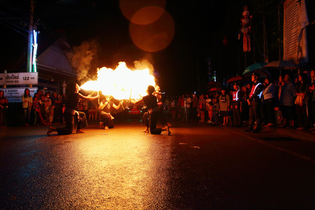 the arts is ancient: Chiang Mai, Thailand - November 6: Performing arts fire sword dance, The arts of the ancient Lanna or ancient people of northern Thailand. in the Loy Krathong festivals on November 6, 2014, in Chiang Mai, Thailand.