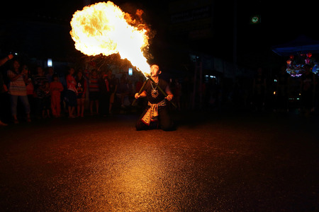 performing arts: Chiang Mai, Thailand - November 6: Performing arts fire sword dance, The arts of the ancient Lanna or ancient people of northern Thailand. in the Loy Krathong festivals on November 6, 2014, in Chiang Mai, Thailand.