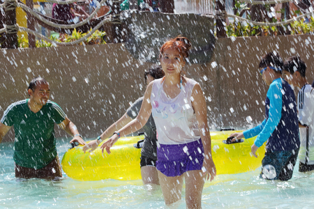 Hua Hin, Thailand - January 2:  Unidentified  tourists enjoy playing with water at the Asias first water jungle Vana Nava, on January 2, 2015 at the Hua Hin, Thailand.