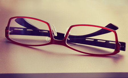 blinkers: Red eyeglasses, retro and vintage tone, soft focus