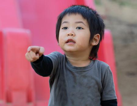 dowdy: Close up asian boy, Asian naughty boy and a sloppy, ragged. Stock Photo