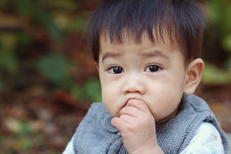 nose close up: Asian boy was sick and runny nose, close up Stock Photo