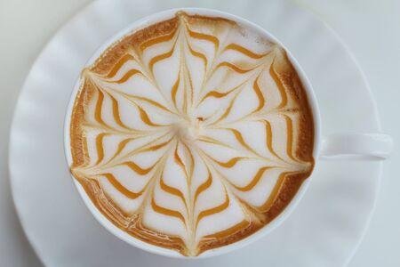 cosiness: Closeup, Hot Caramel Macchiato in white coffee cup