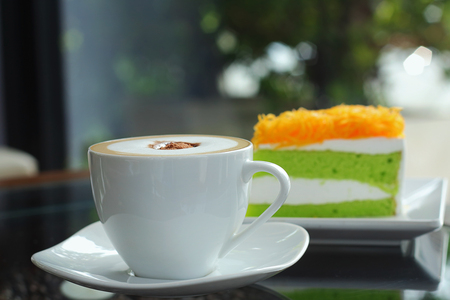 cosiness: Mocha in white coffee cup and Foythong Cake or Gold Egg Yolks Thread Cake in the Coffee Shop