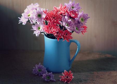 still life flowers, Chrysanthemum in blue vase Stock Photo