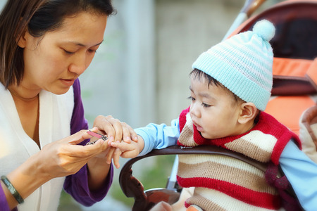 handcare: mother manicure her child.