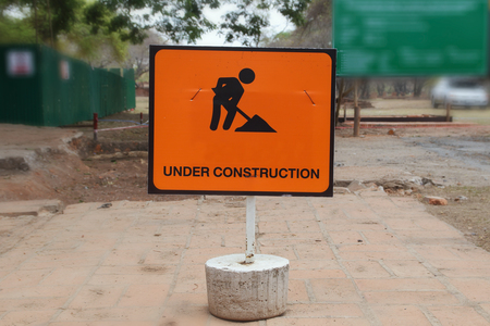 formatting: Orange under construction sign, closeup