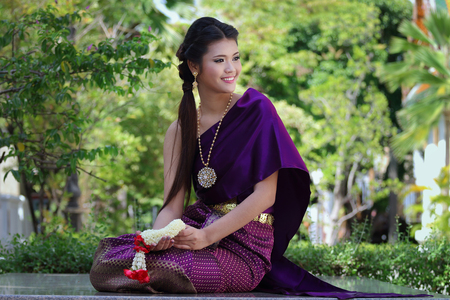national costume: Thailand National Costume, Asian woman wearing thai traditional dress. Stock Photo