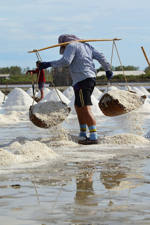 pan tropical: Phetchaburi, Thailand - March 2: Agriculture in Thailand, Workers working in the salt farm in Phetchaburi, Thailand on May 22, 2015.