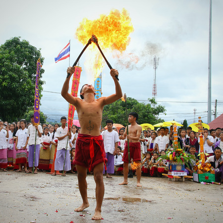 the arts is ancient: Chiang Mai, Thailand - July 29, 2015:  Performing arts fire sword dance, The arts of the ancient Lanna or ancient people of northern Thailand.